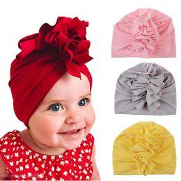 fasce di cappelli appena nati delle neonate Sconti New Cute Baby Girls Turbante cappello misto cotone neonato Beanie Top nodo cappelli fatti a mano compleanno regalo di Natale Baby Girl fasce