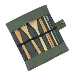 Tenedor cuchillo palillos online-Juego de cubiertos cubiertos de madera de 7 piezas Juego de vajilla de paja de bambú con bolsa de tela Cuchillos Cuchara Tenedor Palillos Viajes al por mayor SSA241