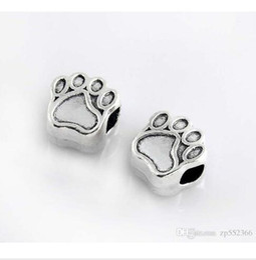 Tibetischen charme katzen online-Katze Hund Paw Print Anhänger Tibet Silber Legierung Charme Pet Footprint Anhänger Spacer Perle Mode Frauen Schmuck Europäischen Für Pandora Armband