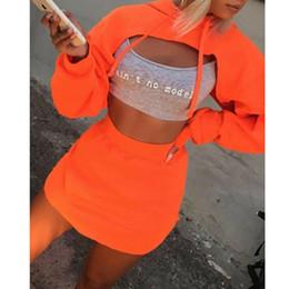 Conjunto de falda sudadera online-2019 otoño invierno Crop Top falda de las mujeres Conjunto sólido con capucha para niños y Mini Falda tubo de hendidura Mujeres Set de 2 unidades