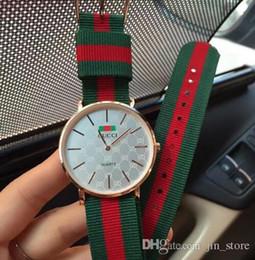 Relojes de mujer militar online-Mujer de lujo Relojes para hombres 40 MM Impermeable a la moda vestido de las señoras hombres de los deportes de los hombres militares reloj de pulsera de cuarzo relojes montre feminino