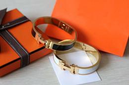 Sac de colle en Ligne-En gros À propos de 17 cm H Bracelet De Mode Femmes Titane Haute Qualité Bijoux 12mm Largeur 18K Plaqué Or Colle Envoyer Avec Sac Pour Les Femmes Cadeau