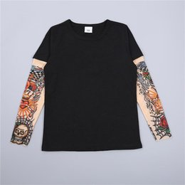 11a18ee58e42 2019 Spring and Autumn New T-shirt for boys and girls European and American children s  long sleeves Stitching hip-hop Tattoo Sleeves T shirt tattoo sleeve ...