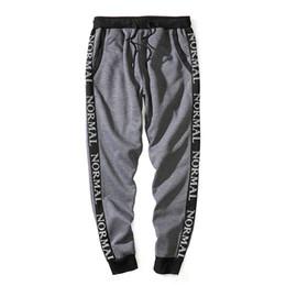 Lazos juveniles online-Pantalón casual, estilo deportivo, hombres, corbata suelta, patrón de carta, pantalones largos, cintura, pantalón elástico transpirable para la tendencia juvenil S-XXL tamaño de la UE