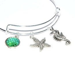 seahorse charm bracelet Coupons - Ancient Silver Seahorse Starfish Fish Scales Charm Bangle Bracelet Steel Ring Adjustable Designer Bracelet Couple Resort Beach Jewelry Gifts