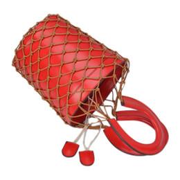 Bolsos de cuero de las mujeres online-Popular Hollow Net Bags Chic Mujeres Bucket Tote Bag Barrel Shaped Lady Vintage Bolsos de cuero Compuesto bolsa