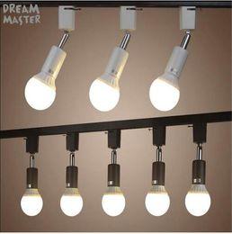 2019 luces de techo para tiendas Lámpara de luz de riel de soporte E27 moderna Iluminación de riel girado para tienda comercial lámpara de iluminación Lámpara de techo de punto negro blanco