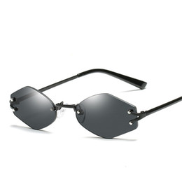 d0b7fbe08d Mujeres sin montura PC Lentes Gafas de sol Moda Marco de metal reflectante  Gafas de sol de la marca de diseño Summer Beach UV400