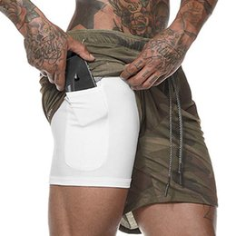 Argentina Nuevo 2 en 1 Pantalones cortos para hombre Pantalones cortos para hombre Pantalones cortos de ejercicio de entrenamiento de secado rápido Gym Sport Shorts con bolsillo incorporado Liner cheap running pocket Suministro