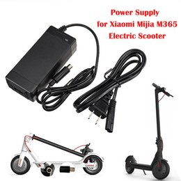 Canada Chargeur universel de batterie au lithium EU / AU / UK / US du chargeur Hoverboard pour le scooter électrique 10pcs DHL de Mijia M365 / ES2 Offre