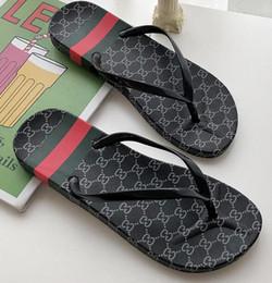 zapatillas de uso doméstico Rebajas 2019 nuevas sandalias de verano y zapatillas de playa planas antideslizantes chanclas de playa en casa con la moda de arrastre de letras salvajes