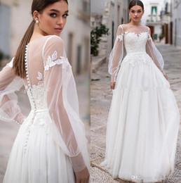 2019 vestidos de novia únicos de invierno Vestidos de novia elegantes y modestos de encaje Bohemia Cuello de joya transparente Mangas largas Apliques de encaje Una línea Vestidos de novia de boda con botones