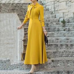 línea de estilo de moda de oficina Rebajas Señoras elegantes amarillo de manga larga vestido de oficina de la manera una línea más el tamaño del Bowknot del estilo coreano del otoño de las mujeres del vestido largo maxi