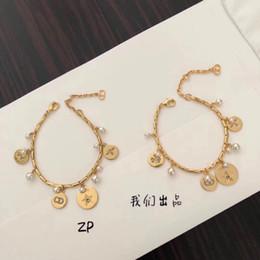 grossistas pulseiras magnéticas para homens Desconto O glamour das mulheres novas moda selvagem cheio de diamantes H carta brincos série deusa de estilo