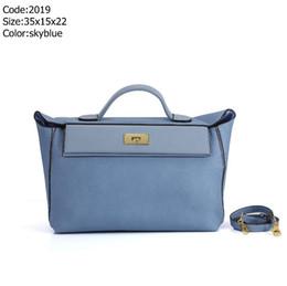 Los más vendidos Marca Moda Mujer Bolso de gran capacidad Bolsos de diseño Bolsos de mano Mujer Bolsos de embrague Niñas azul Bolso de cuero genuino desde fabricantes