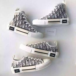 2019 nuovi pattini 19ss progettista degli uomini OBLIQUE Homme 091533Ðior X Kaws0 da Kim Jones B23 Casual Shoes High Top Sneakers da pantofole di strada fornitori
