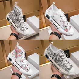 Zapatos ocasionales de las mujeres con cordones ligeros transpirables para mujer moda zapatillas de deporte plataforma B23 High-Top zapatillas en zapatos oblicuos de mujer desde fabricantes