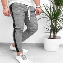2019 pantalones de hombre de moda Moda de moda para hombre pantalones de raya lateral Compruebe Chándal Faldas sudaderas Pantalones a cuadros Gimnasio cordón elástico pantalones de cintura rebajas pantalones de hombre de moda