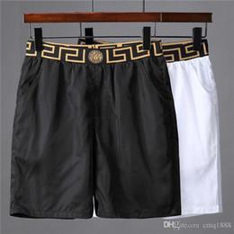 Nuevos estilos mens pantalones casuales online-2019 nuevo estilo de tela impermeable pantalones de verano pantalones de playa Pantalones cortos de tabla para hombre Pantalones cortos de surf Pantalones cortos de natación Pantalones cortos deportivos