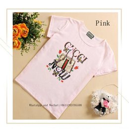 Camisetas de moda coreana online-Chica Ropa de verano Camiseta de manga corta T camiseta linda de tamaño mediano y para niños pequeños Edición coreana Chaqueta Marea