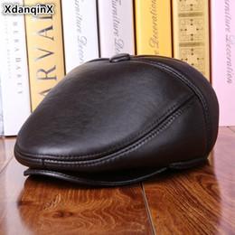 XdanqinX Nuovo cappello da donna invernale caldo cappelli in vera pelle di  pelliccia di pecora di spessore berretti da uomo in pelle paraorecchie  berretti ... 6dc477c370d8
