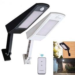 Lámpara de poste de luz al aire libre jardín online-900lm Led Solar Light Outdoor Lighting impermeable para jardín de pared 48 leds Cuatro modos Rotable Pole Solar Lamp Newest