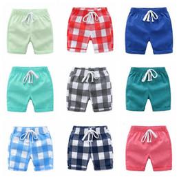 pantalon bébé fille Promotion Vêtements de designer pour enfants bébé à carreaux shorts garçons été pantalon solide fille vérifiée pantalons treillis demi-pantalon cordon pantalon Streetwear B5418