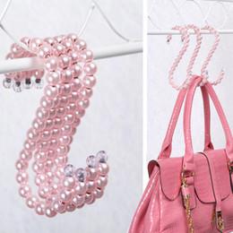 Perchas de plástico rosa online-1PCS Bolsa de perlas perchas percha 16 CM bolsa de gancho de la percha de plástico mujeres de la manera clips blanca rosa ángel negro en forma de gancho en S