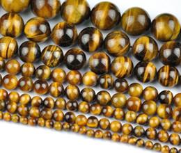 Perline per la produzione di fascette per gioielli online-Commercio all'ingrosso naturale tiger eye rotondo perline di pietra allentata per monili che fanno braccialetto fai da te collana 4/6/8 / 10mm filo 15 ''