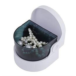 Argentina Mini máquina de limpieza de joyas por ultrasonido exquisita, de operación simple, fácil de transportar y limpiar las características. Suministro