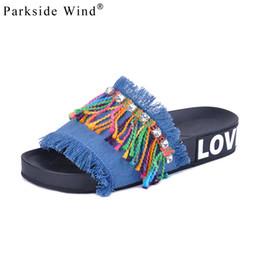 Parkside Wind Denim Sandalias Mujer Diapositivas Zapatillas planas Damas Cristal Fringe Zapatos de color caramelo Sandalias de playa XWT0199-5 desde fabricantes