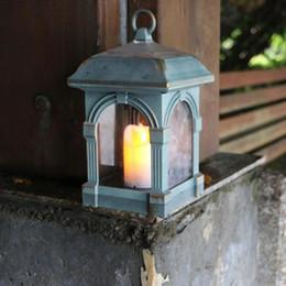 Linterna solar para decoración. online-Forma de linterna de vela Luz solar LED Impermeable Lámpara colgante para el hogar al aire libre Camino de luz solar Jardín de césped Lámparas de jardín Decoración