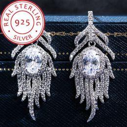 Tüy küpe kadınlar için tam elmas küpe 925 Gümüş küpe tanrıça yemeği High-end lüks Alev şekli küpe Fabrika Fiyat nereden