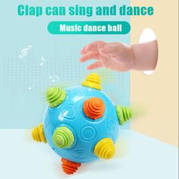 Vieux jouets en Ligne-Musique Vibration Dancing Ball Fenêtre Box Baby Jump Ball Puzzle Jouet pour 1-3 ans Bébés avec TPR Matériel en tant que partie exceptionnelle de l'ABS