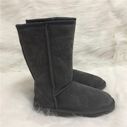 2019 botas largas de cuero mujer invierno botas de mujer zapatos de diseño estilo australiano mujer botas de nieve unisex impermeables botas largas de cuero de invierno marca UG IVG botas largas de cuero mujer invierno baratos