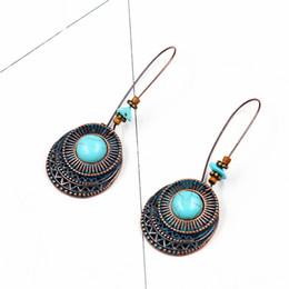 Legno turchese online-Moda rotonda del turchese della lega pendente degli orecchini String Perle scava fuori Eardrop Charme regali del partito gancio dell'orecchio di gioielli per le donne