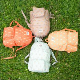 Korea sacos de escola on-line-Designer-atacado homens mulheres hot animal de viagem de armazenamento à prova d 'água Dos Desenhos Animados dobre mochila Shoulders saco escola impressão Coréia frete grátis