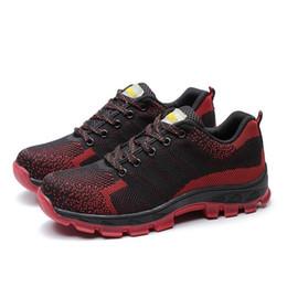 2018 Men Toe Scarpe di sicurezza per uomo Scarpe da trekking moda Scarpe da  lavoro da costruzione Calzature uomo Calzature di gomma Taglia 35-46 scarpe  da ... f43f1467525