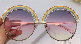 Moda popüler güneş gözlüğü yuvarlak çerçeve gökkuşağı en kaliteli basit ve cömert tarzı ile danb koruma gözlük kutusu 1064 cheap rainbow frame nereden gökkuşağı çerçevesi tedarikçiler