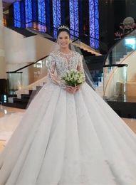 vestidos brancos pretos da recepção de casamento Desconto Luxury Crystal Beaded Long Sleeves Ball Gown Wedding Dresses Vintage Lace Appliiqued Saudi Arabic Dubai Bridal Gown Plus Size