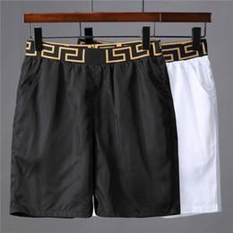 Costume nero dell'uomo online-pantaloncini estivi da uomo impermeabili e ad asciugatura rapida costumi da bagno firmati da uomo bianco nero pantaloncini da spiaggia da uomo costumi da bagno da bagno da uomo
