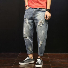 Europa harem pants moda online-Jeans esplosione moda giovane foro jeans uomo pantaloni harem denim uomo europa america stile sciolto plus size 5XL cowboy strappati hombre