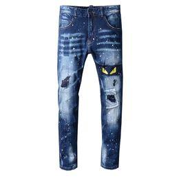 Jeans man 29 tamanho on-line-Nova Itália Estilo dos homens Afligido Monstro Amarelo Olhos Bordados Calças de Oiled Azul Calça Jeans Magro Calças Tamanho 29-40