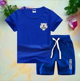 Stampa della maglietta del bambino online-KZ Logo del marchio Designer di lusso Abbigliamento per bambini Imposta Vestiti estivi per bambini Stampa per abiti da bambino T-shirt da bambino moda Tute per bambini