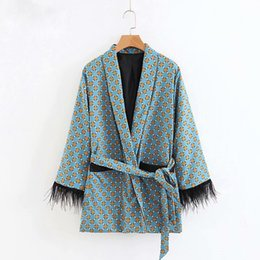 Argentina Chaqueta de moda Las mujeres suelta Kimono Escudo Bow Tie Fajas Bolsillos Borla Decorar Prendas de abrigo Oversized Ladies Autumn cheap floral tassels loose kimono Suministro