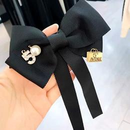2019 pajarita negra mujer Lindo negro Bowknot broches moda Streamer largo pajarita para la muchacha de alta calidad negro pernos moda joyería femenina pajarita negra mujer baratos