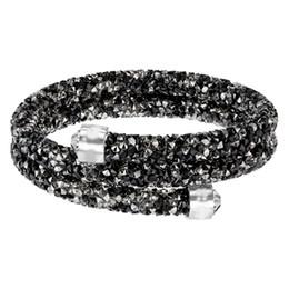 aa65fd228401 Swarovski nuevo cristal salvaje color mágico personalidad de la moda simple estrella  polvo espiral doble anillo pulsera oscuro 5237757