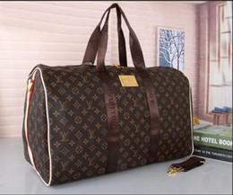 Bolsas de couro para viagem on-line-2019 homens duffle bag mulheres sacos de viagem bagagem de mão designer de luxo bolsa de viagem homens pu bolsas de couro grande corpo cruz saco totes 52 cm