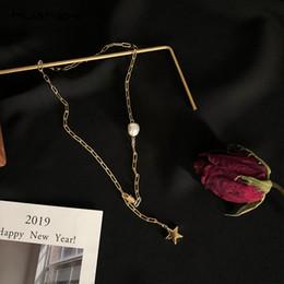 Cadena corta de oro diseña mujeres online-HUANZHI Perlas de Agua Dulce Estrella Colgante Elegante Color Oro Diseño de Metal Elegante Cadena Corta Collares Para Las Mujeres Joyería Del Partido de Las Niñas