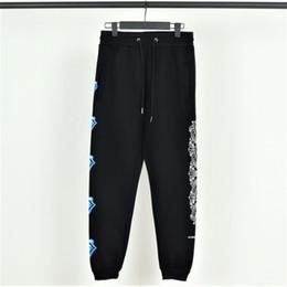Pés de veludo on-line-Mens de luxo famoso de Hollywood sweatpants Chromes corações jeans de grife Azul grande língua com calças de veludo Feixe de pé casual casal calças